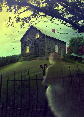 Abandoned haunted house on the hill with ghost