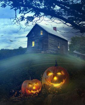 Halloween pumpkins in front of Spooky house