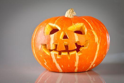 halloween, old jack-o-lantern on grey