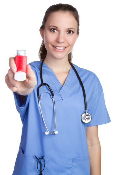 Beautiful nurse holding asthma inhaler