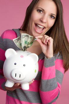 Woman taking piggy bank money