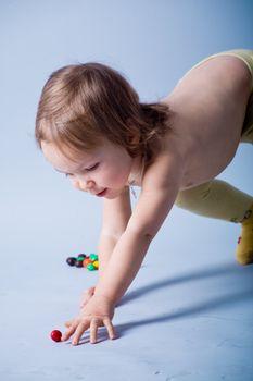 Kid girl reaching small ball