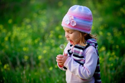 Child with dandelion