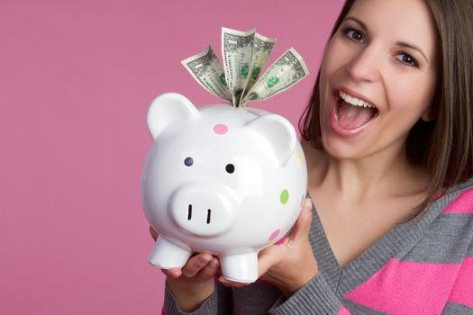 Smiling girl holding piggy bank