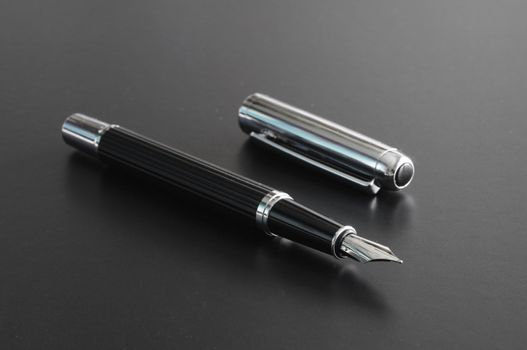 pen showing communication contact us or mail concept on black background
