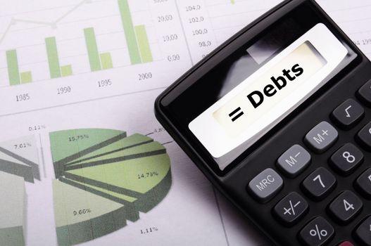 financial debt or credit concept with calculatur