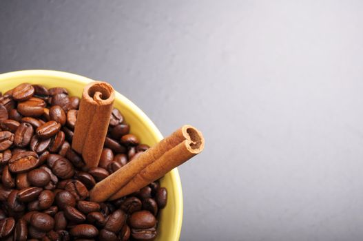coffee beans and cinnamon with copyspace showing food concept