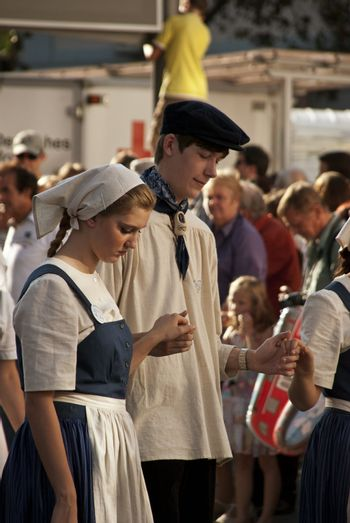 Day of German Unity,  festive parade, young couple in old fashioned clothes, photo taken in Bonn on the 3 of October 2011