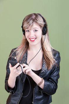 Teenaged Girl with Handheld Phone or Audio Device