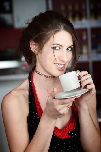 Pretty Young Woman Tasting Coffee