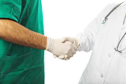 healthcare and medicine: nurse and surgeon hand shaking