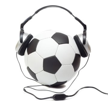 classic soccer ball in headphones, isolated on white