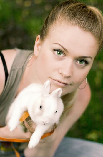 girl with her white rabbit
