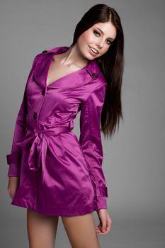 Young woman wearing purple raincoat