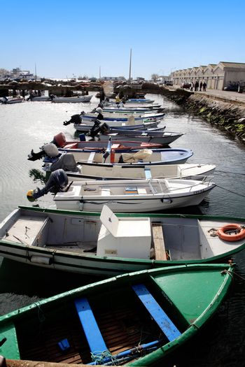 Several aligned fishing boats on the docks of Olh�o, Portugal.