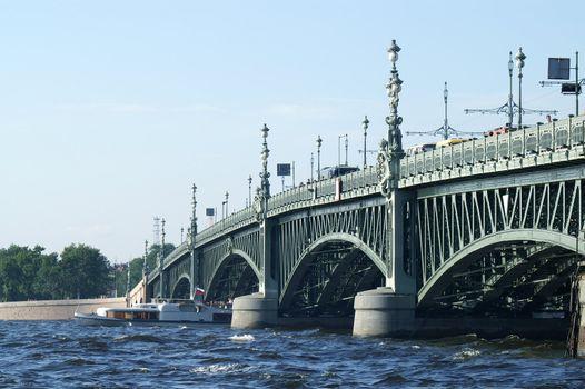 Boat under Troitsky Bridge in Saint Petersburg, Russia.