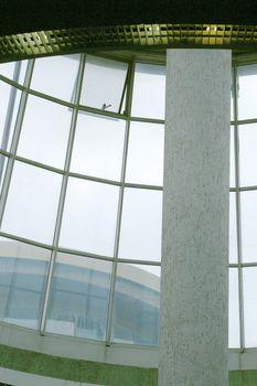Glass Atrium with Concrete Column in Airport