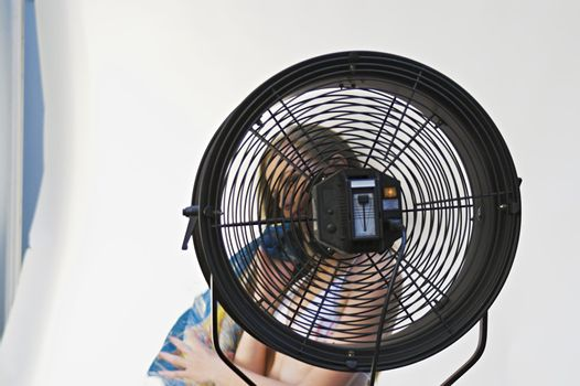Girl Behind Fan, with Face Unclear