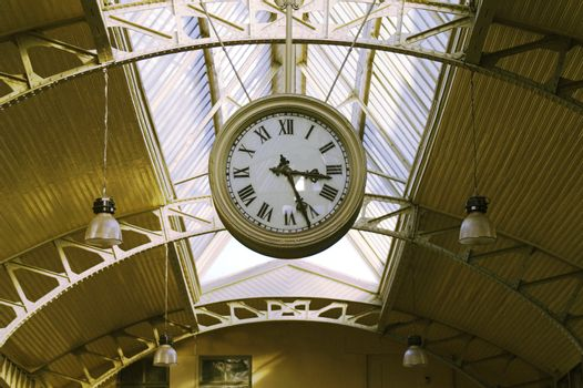 Big hanging public clocks in a railroad station hall, Vitebsk Railroad Station, Saint Petersburg, Russia.