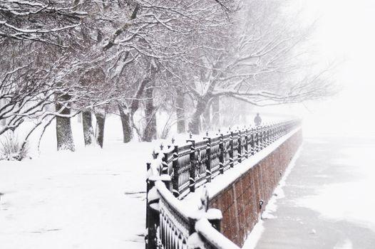 The Kronverk embankment at snowfall in Saint Petersburg, Russia.