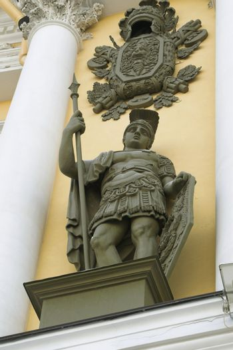 A bronze sculpture of a ancient roman warrior.