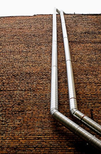 Pipework on a brick wall.