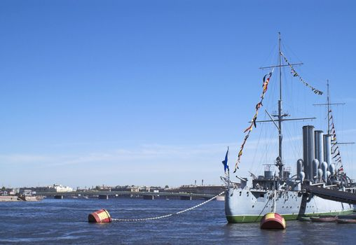The stern part of famous cruiser Aurora (relating to the Russian October 1917 revolution) now docked for ever as a museum at Petrogradskaya embankment opposite the Nakhimovskoi Naval School in Saint Petersburg. (The ship name is erased in the image.)
