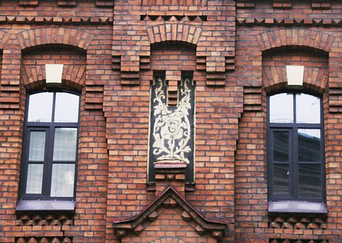 A detail of the brick facade of an old building in Saint Petersburg, Russia.
