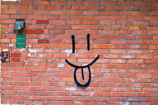 Smile Graffiti on Red Brick Wall.