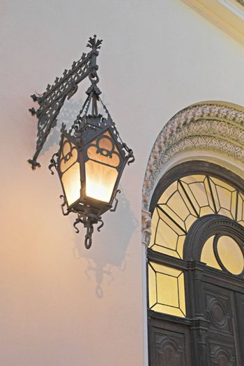 Old lamp on a cathedral's wall at evening. The entrance to the German Evangelic Lutheran Church in Saint Petersburg, Russia.