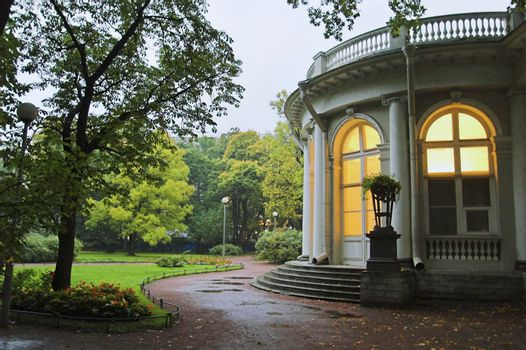 A palace in an early autumn park at evening in Saint Petersburg, Russia.