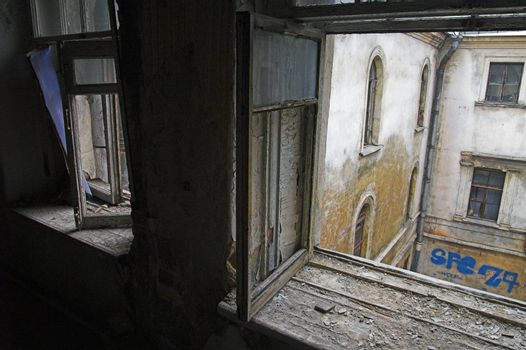 View through window in abandoned house to backyard
