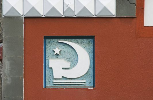 Soviet-style decorative detail on a building wall.