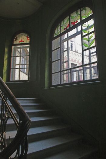Stairway and stained-glass windows in old building