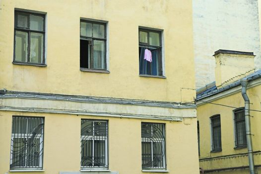 Dress hanging to dry in open window of old building