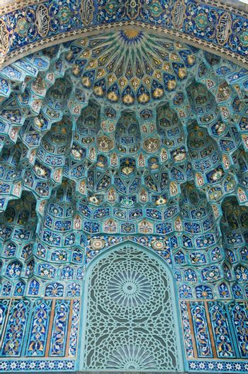 Fragment of a tiled wall with Arabic mosaic of an ancient mosque in Saint Petersburg, Russia.