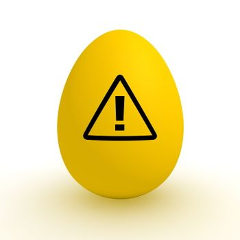 a single yellow egg with a black attention warning sign on it - poisoned food