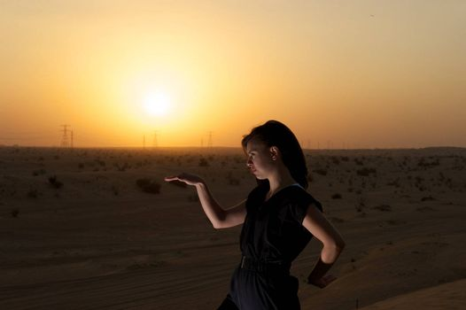 Woman enjoying the desert in Dubai, United Arab Emirates