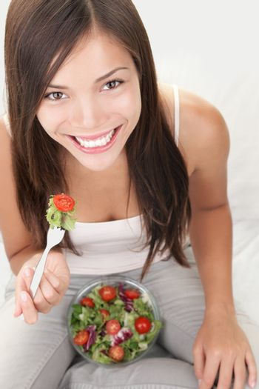 Salad woman eating healthy