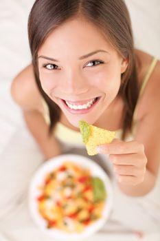 Woman eating nachos