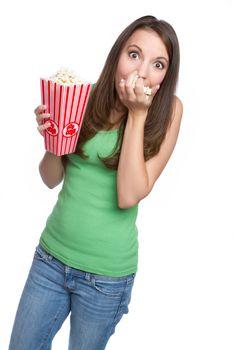 Isolated teenage girl eating popcorn