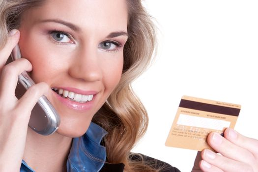 Smiling woman holding credit card