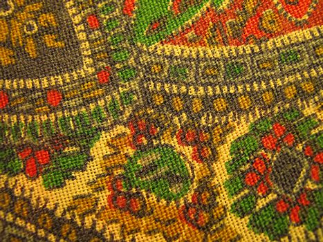 A photograph of paisley fabric detailing its pattern.
