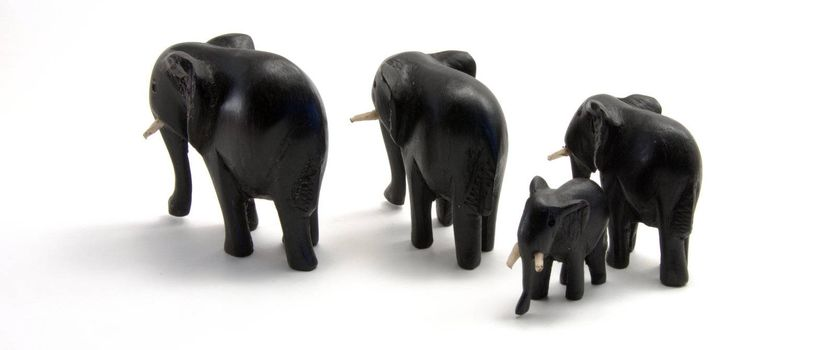 Family of wood elephants carved from wood
