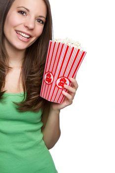 Smiling teenage girl eating popcorn