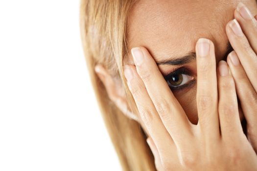 shy woman looking through fingers