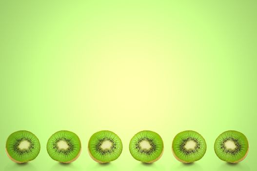 Six small kiwi fruit halves arranged in a horizontal line along the bottom of the image with green light effect filter background