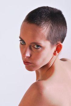 Woman with short hair facing camera