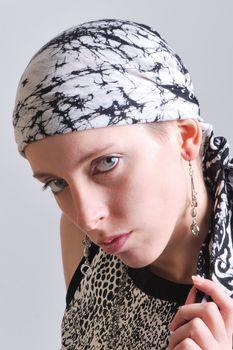 Head of woman in black scarf
