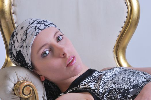Attractive woman lying back on chair